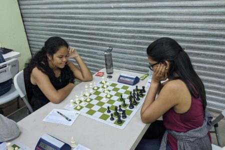 Sasha Christina Shariff (left) competing against Yolander Persaud at the 2020 Women's Chess Championship Qualifier Tournament. Both players represented Guyana at the 2020 Online Olympiad.