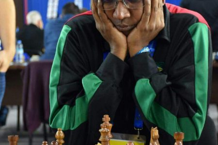 Loris Nathoo competing at the 2018 Chess Olympiad in Tbilisi, Georgia. At the 2018 Olympiad, Nathoo captained the Guyana team and competed as a player. At the 2020 Online Olympiad which officially concludes today, Nathoo also captained the Guyana team.
