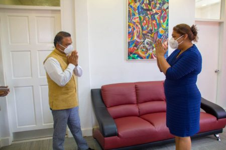 High Commissioner of India to Guyana, Dr K J Srinivasaand  Minister of Education Priya Manickchand greeting each other yesterday at her office. The High Commissioner discussed various avenues of possible cooperation and exchange of best practices in the education sector between India and Guyana, a release from the High Commission said. (Indian High Commission photo)