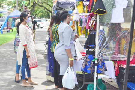 Persons shopping last Wednesday along the Main Street avenue, where some vendors showcased attire and craft for Emancipation celebrations (Photo by Orlando Charles)