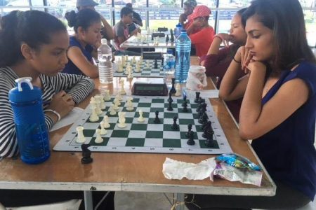 Yolander Persaud (at right), who is representing Guyana in this weekend's games at the 2020 Chess Olympiad