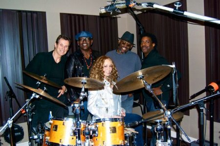 Mariah Carey (seated) with (from left) a drummer, Randy Jackson, Loris Holland and guitarist Doc Powell.