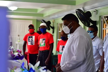 The President paying his respects at the Sandy's funeral parlour. (Office of the President photo)