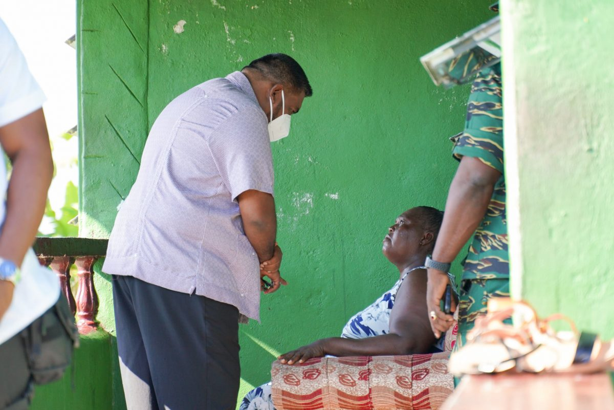 President Irfaan Ali [left) meeting with a family member of one of the slain teens today. (Office of the President photo)