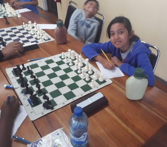 Children at a chess tournament in Georgetown