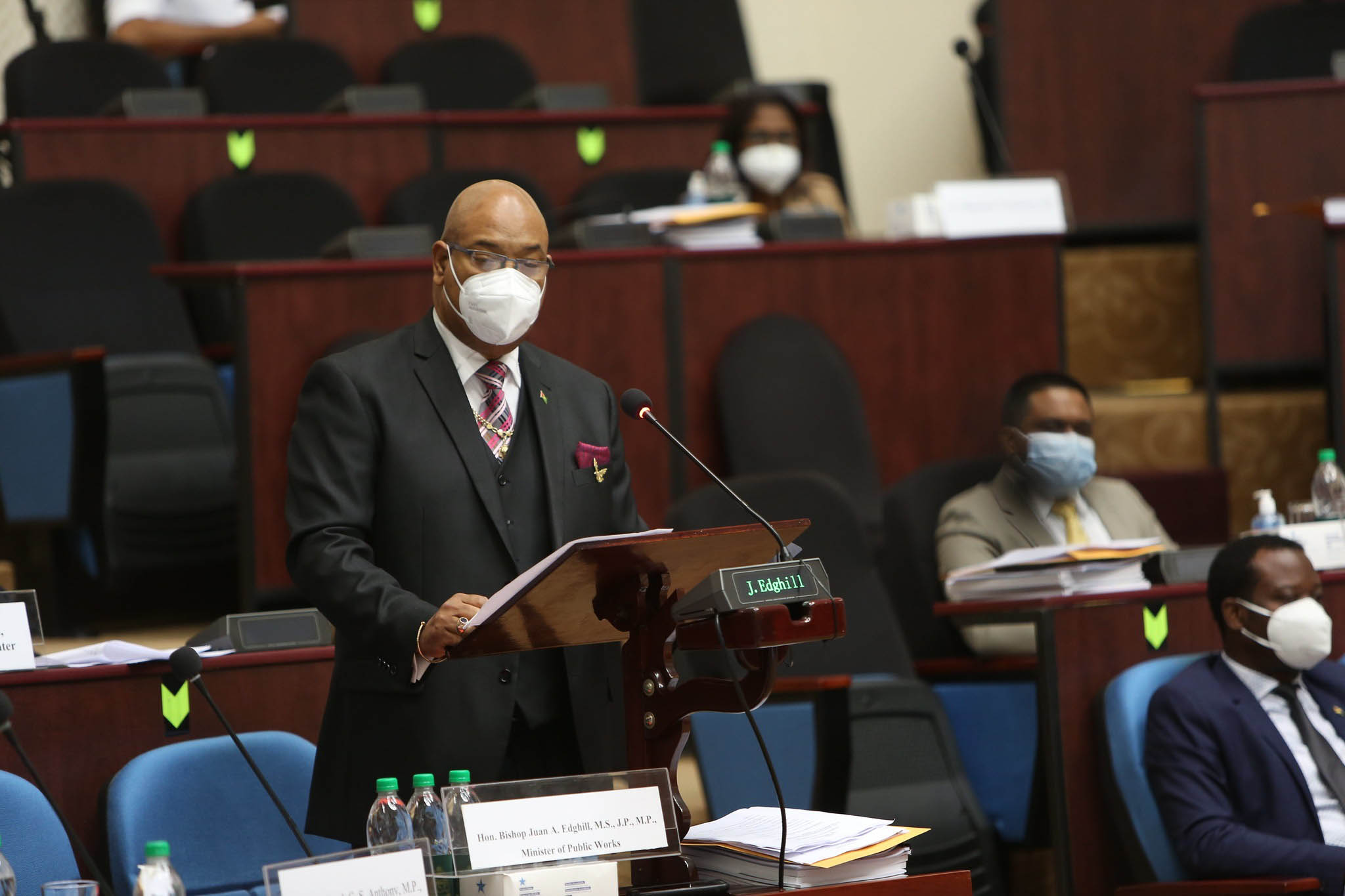 Public Works Minister Juan Edghill reading the budget speech (Department of Public Information photo)