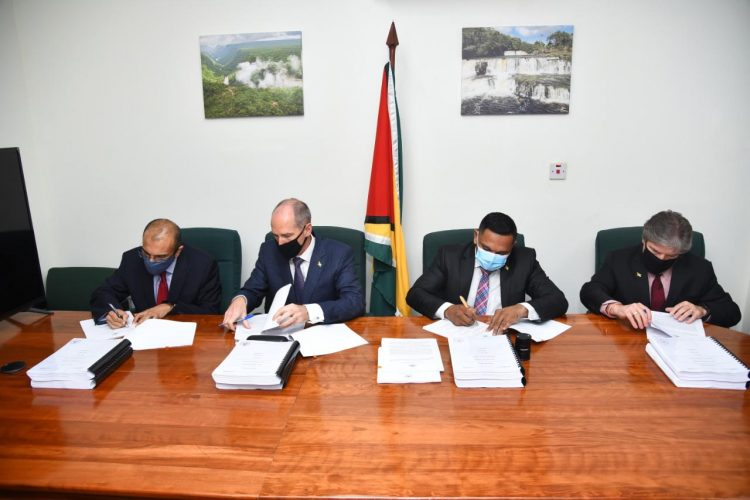 From left to right are: Anand Gohil – Executive, CNOOC Petroleum Guyana Limited; Alistair Routledge – President of Esso Exploration and Production Guyana Limited; Vickram Bharrat, Minister of Natural Resources and Timothy Christian – Director and Vice President of Hess Guyana Exploration. (DPI photo)