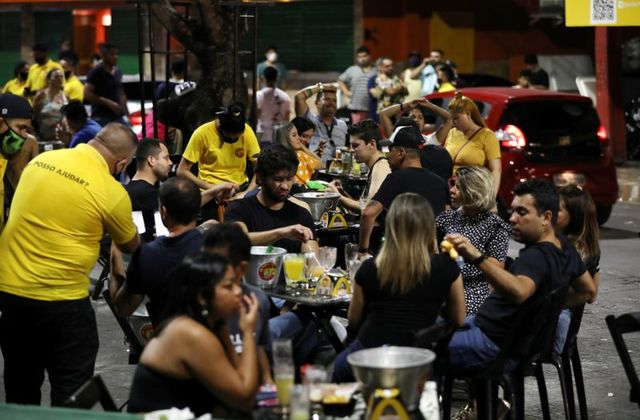 People enjoy at a bar after a Manaus City Hall decree that determined the closure of bars and restaurants was issued, amid the coronavirus disease (COVID-19) outbreak in Manaus, Brazil, September 25, 2020. REUTERS/Bruno Kelly/File Photo