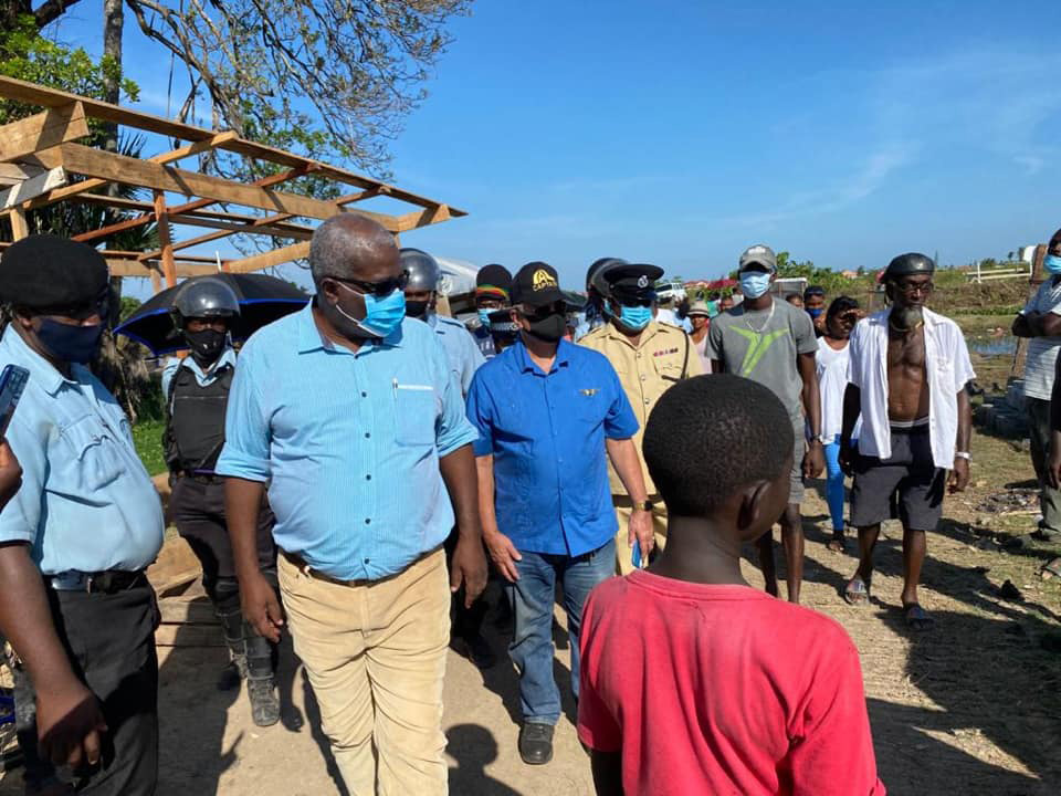 Prime Minister Mark Phillips during a visit yesterday to Success, East Coast Demerara, squatting area (Photo from President Irfaan Ali's Facebook page)