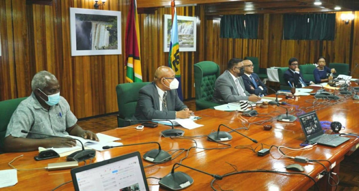 President Irfaan Ali [third from left) with government ministers and Vice President Bharrat Jagdeo during the conference. (Office of the President photo)