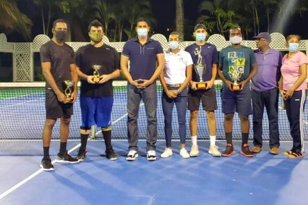 Minister of Culture, Youth and Sport Charles Ramson Jr. poses for a photo with the contenders of the just concluded ITF Safe Tennis tournament