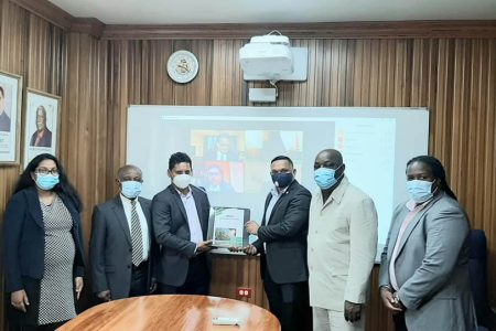 Shyam Nokta (third from left) handing over the report to Minister of Natural Resources Vickram Bharrat (Department of Public Information photo)