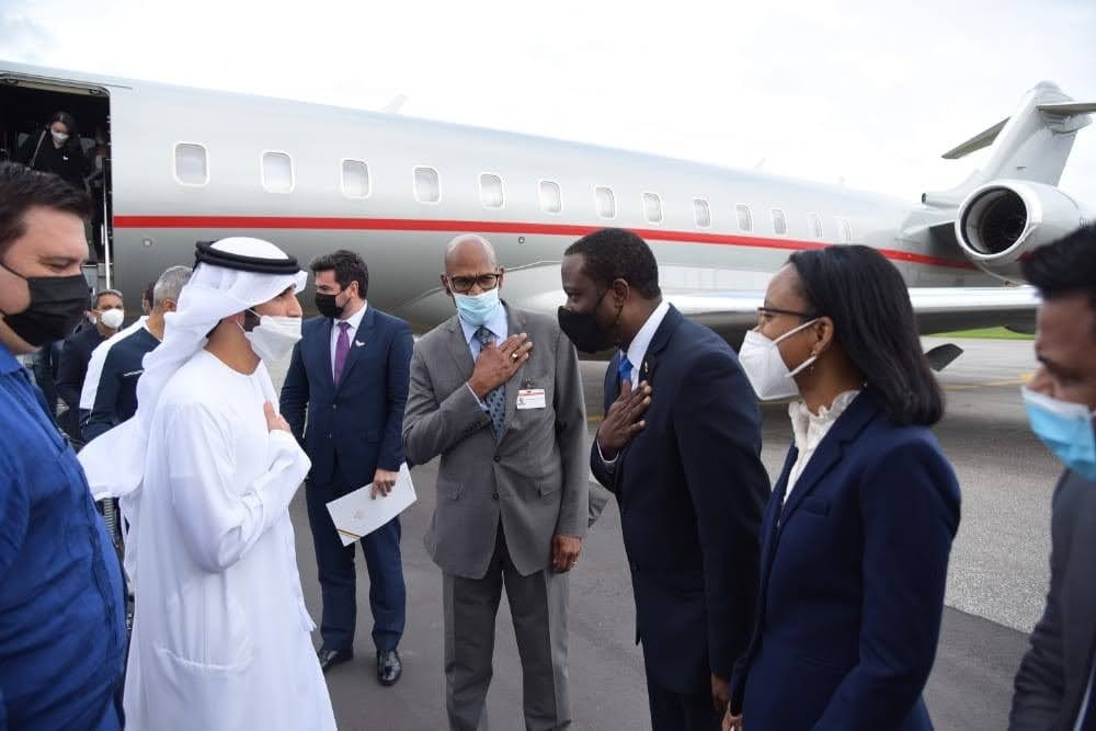 Sheikh Ahmed Dalmook Juma Al Maktoum of the UAE (second from left) being welcomed to Guyana by Minister of Foreign Affairs Hugh Todd. (CJIA photo)