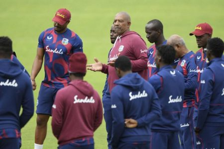 West Indies head coach, Phil Simmons with some of the players