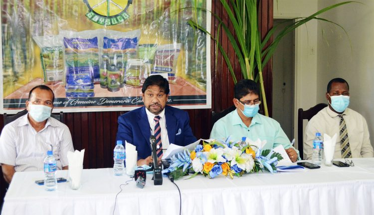 CEO Sasenarine Singh (second from left) with the GuySuCo panel