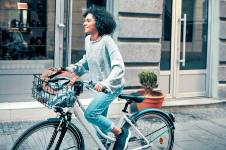 A woman on her bicycle. (https://www.healthline.com photo)