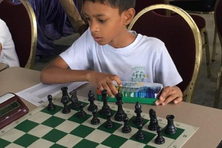 Arysh Raghunauth is already a two-year veteran of the game at 10 years of age. He defeated Bermuda's Flaganan Daylan and William Antony Salvane. Raghunauth had lost to Daylan in the 2019 Carifta Games in Curacao. He is being tutored by the Indian International Master Atanu Lahiri and is a student at Mae's Under 12 school.