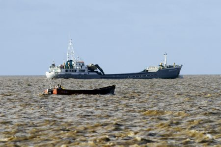 I'll race you! A fishing boat and a ship as seen from the Kingston seawall on Thursday. (Orlando Charles photo)