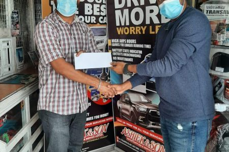 Ray Ali (left) hands over the sponsorship to BCB's Ameer Rahaman.