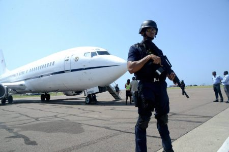 A policeman is seen monitoring an extradition exercise at the Norman Manley International Airport in this April 2017 photograph. A Jamaican man was extradited to the United States in January 2021 after more than 20 years on the run.