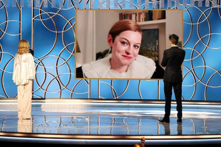 """Emma Corrin accepts the Best Television Actress - Drama Series award for """"The Crown,"""" via video, from Kyra Sedgwick and Kevin Bacon in this handout photo from the 78th Annual Golden Globe Awards in Beverly Hills, California, U.S., February 28, 2021. Christopher Polk/NBC Handout via REUTERS"""