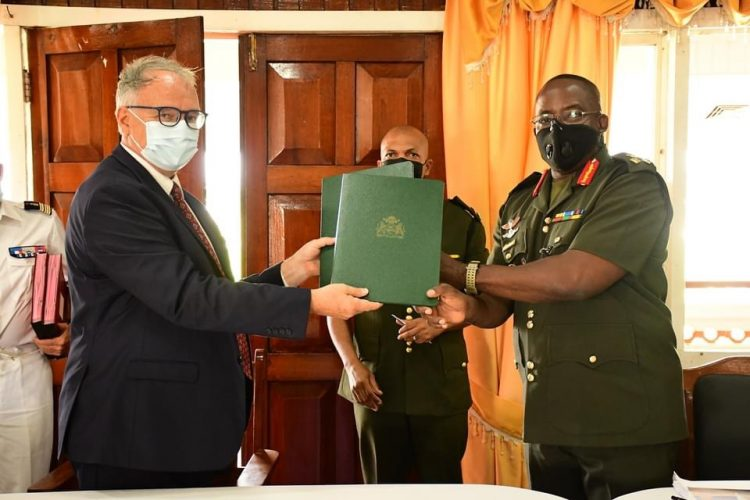 Guyana Defence Force  Chief of Staff Brigadier Godfrey Bess (right) and French Non-Resident Ambassador to Guyana Antoine Joly exchanging the signed document. (GDF photo)