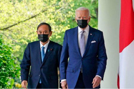 President Joe Biden (right) with Japanese Prime Minister Yoshihide Suga yesterday