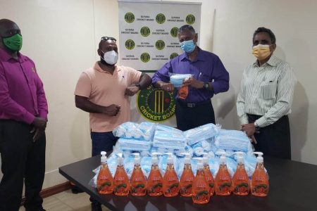 Manager of GuyBiz Ishwar Singh (second from left) hands over the supplies to GCB's Assistant Secretary, Davteerth Anandjit, in the presence of GCB secretary, Ronald Williams (right) and Territorial Development Officer Colin Stuart