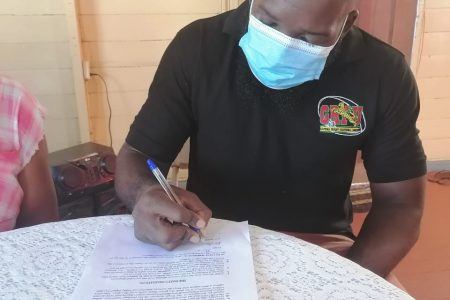 President of the Union, Ryan Dey, signing the agreement yesterday