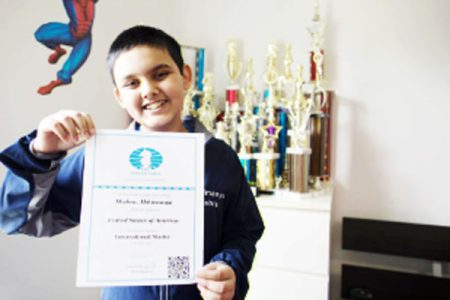 Abhimanyu Mishra, 12, displaying his FIDE International Master certification. In chess, an International Master precedes the illustrious grandmaster title. Mishra is on his way to becoming the youngest grandmaster in the history of the game. (Photo: Justin Lane/US Chess)