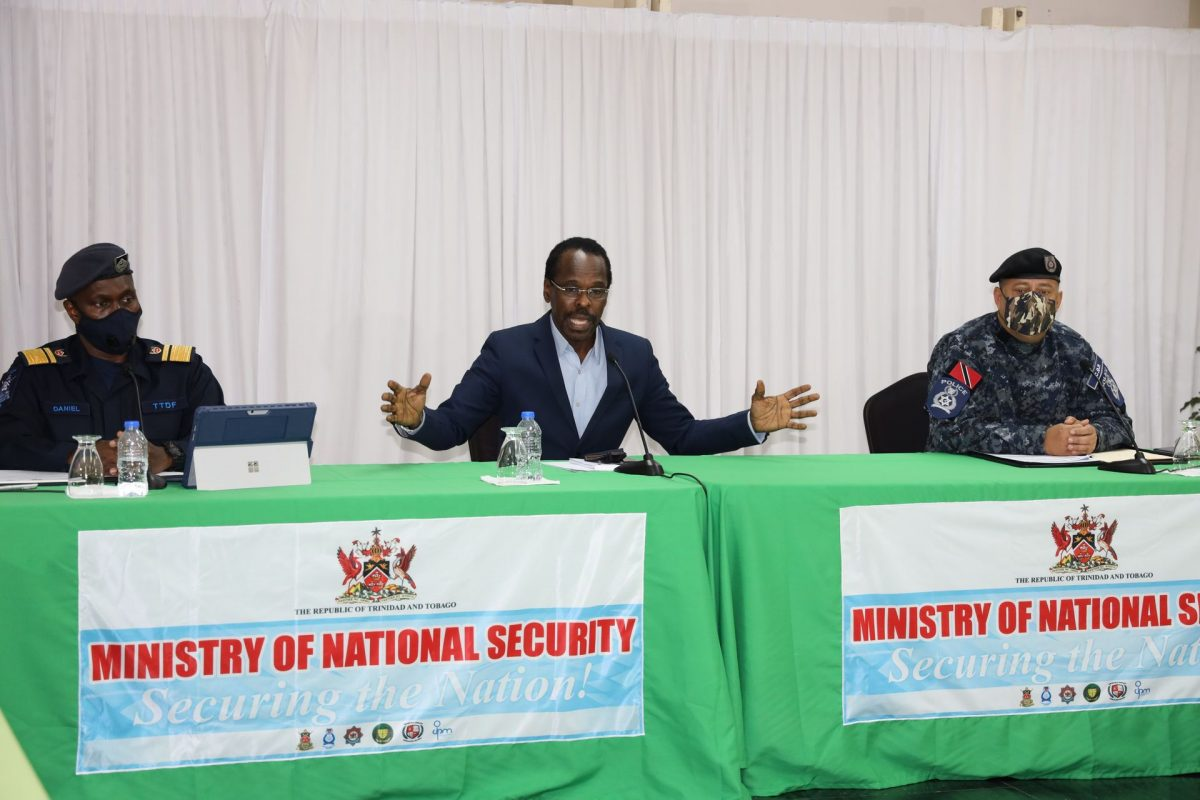 National Security Minister Fitzgerald Hinds (centre) speaks to members of the media during a press conference at the National Security Ministry Abercromby Street, Port-of-Spain, on Sunday. Looking left is Chief of Defense Staff Air Commodore Darryl Daniel and Commissioner of Police Gary Griffith right.