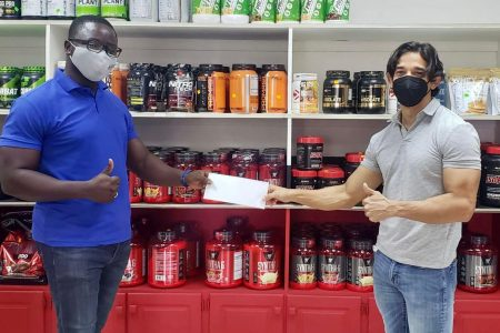 Yesterday, owner of Guyana's leading gym equipment and supplement supplier, Jamie McDonald presented a sponsorship cheque to President of the GBBFFI, Keavon Bess.