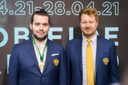 Russia's Ian Nepomniachtchi (left) poses with his coach Vladimir Potkin during the closing ceremony of the Candidates Tournament. (Photo: Lennart Ootes/FIDE)