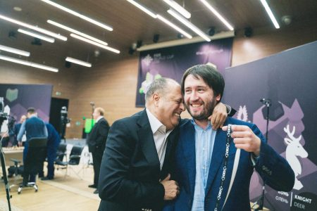 Azerbaijan grandmaster Teimour Radjabov (right) being congratulated by a well-wisher following the announcement that he was selected to participate in the prized FIDE 2022 Candidates Tournament. (Photo: FIDE)