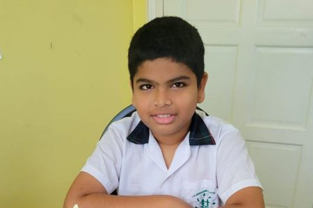 Omar Shariff emerged victorious at the trials for the FIDE Online Rapid Cadets and Youth World Cup and will represent Guyana in the U-12 category at the competition next week. (Photo: John Lee)