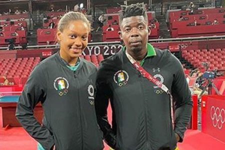 Chelsea Edghill and her coach  former Caribbean boys singles champion Idi Lewis.