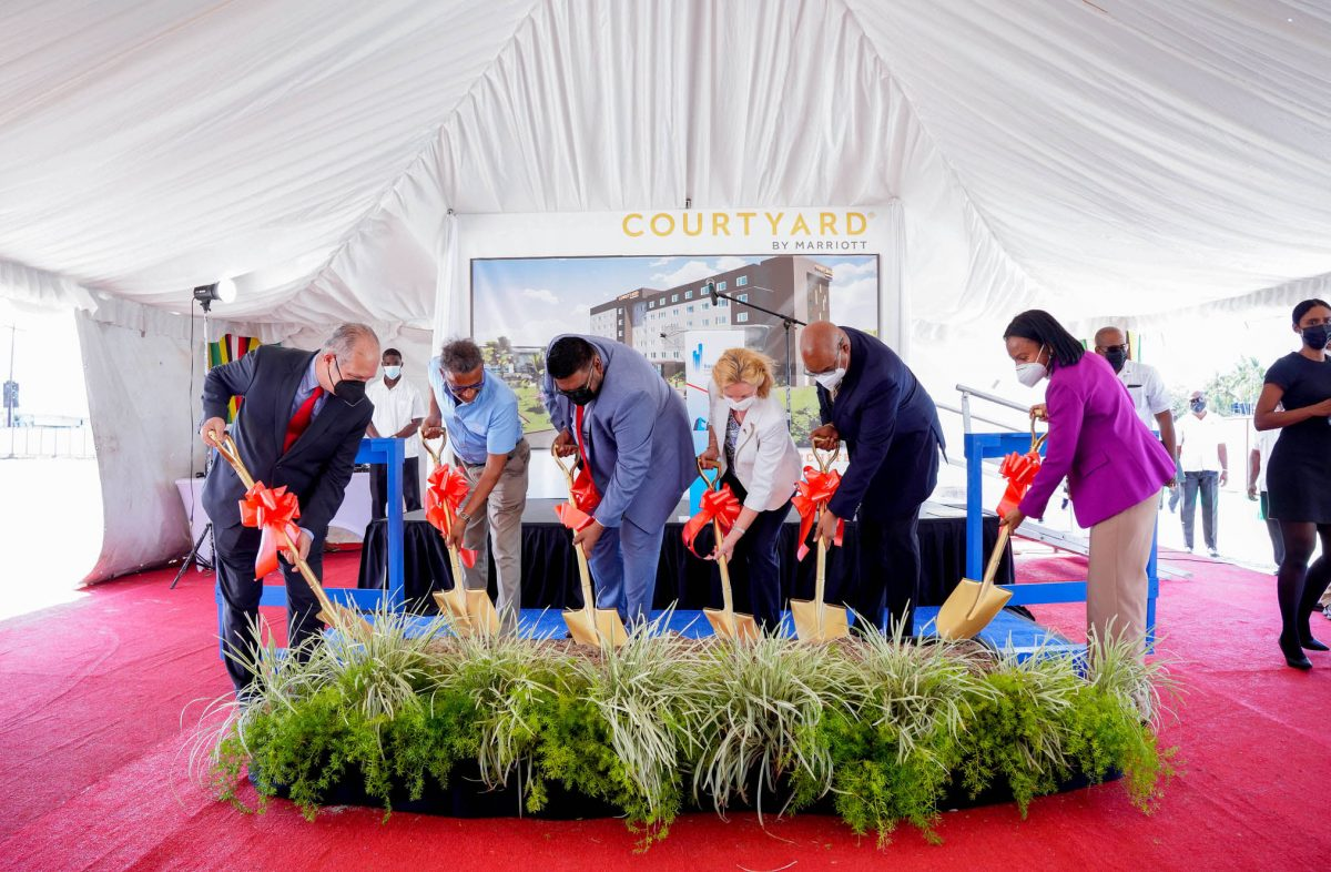 President Irfaan Ali (third from left) is joined by US Ambassador Sarah-Ann Lynch (third from right), Public Works Minister Juan Edghill (second from right), Minister of Tourism and Industry Oneidge Walrond (at right), Roy Bassoo (second from left) and an official from the Marriott chain in turning the sod yesterday. (Office of the President Photo)