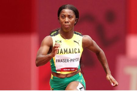 Jamaican Shelly-Ann Fraser-Pryce runs during her opening round heat in the 100m.