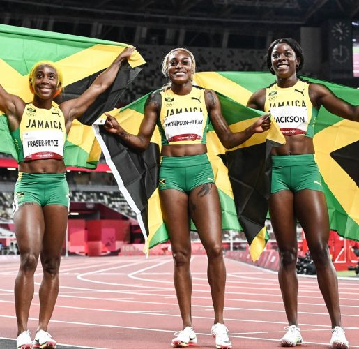 WORLD's BEST! From left, Shericka Jackson, Elaine Thompson-Herah and Shelly-Ann Fraser Pryce after their domination of the women's 100m final in Tokyo, Japan yesterday.
