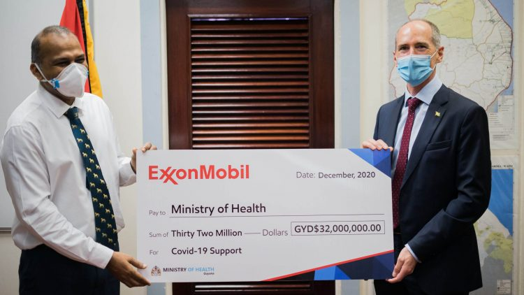 Creating deeper onshore footprint: ExxonMobil's Alistair Routledge and Health Minister Frank Anthony