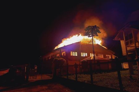 The North West Secondary School in Mabaruma, Region One ablaze last night. According to reports, the fire started just around 10 pm. Regional Chairman, Brentnol Ashley told this newspaper at around 11:15 pm that the fire had already devoured the main building and that volunteer firemen were on the scene in an attempt to save neighbouring structures. The origin of the fire is thus far unknown. (Photo courtesy Brentnol Ashley)