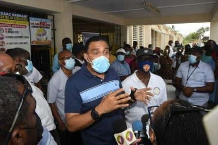 Prime Minister Andrew Holness addresses members of the media while touring the COVID-19 vaccination site at Isaac Barrant Health Centre in St Thomas, yesterday. (Photo: Karl Mclarty)