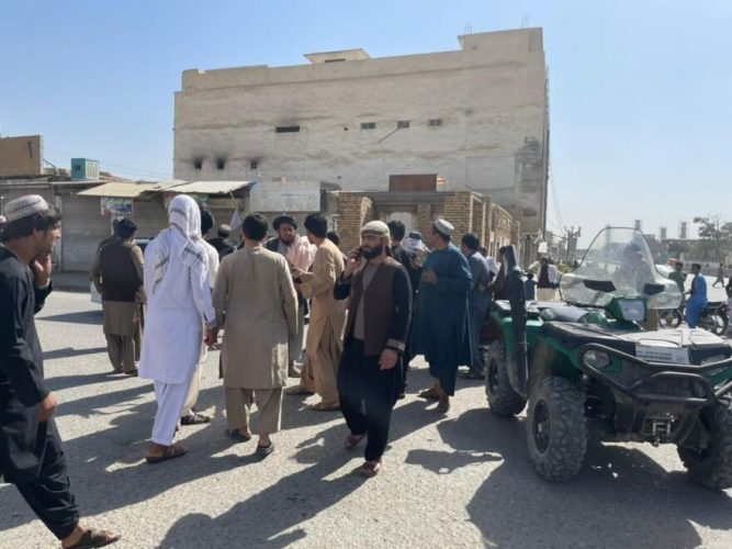 People gather at the scene after a bomb blast hits a Shiite mosque in Afghanistan's southern Kandahar province on Friday.