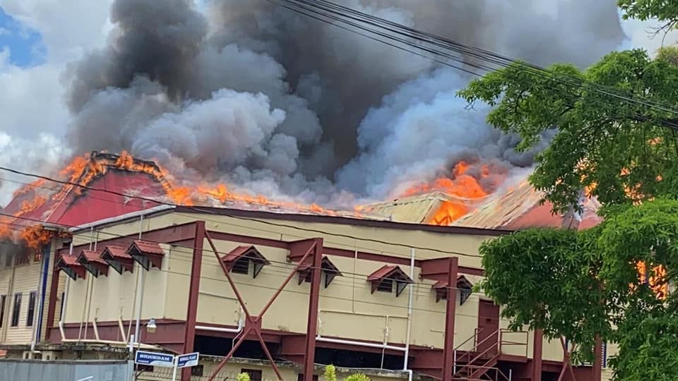 The Brickdam Police Station on fire yesterday (Police photo)